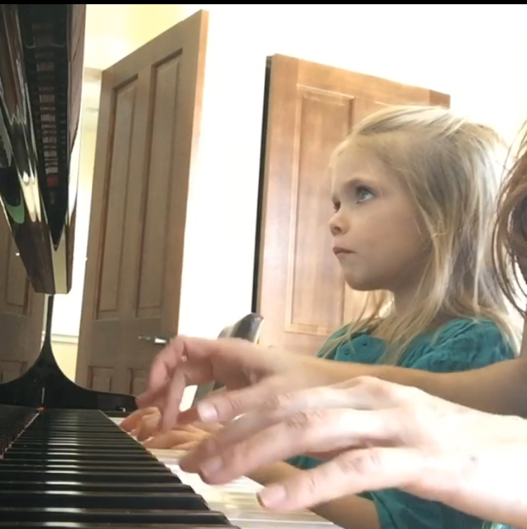 Working on a Beethoven duet with my daughter.