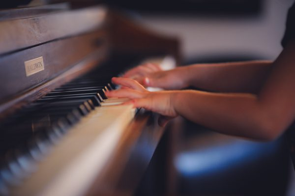 Adult Piano Lessons: How They Benefit Your Child